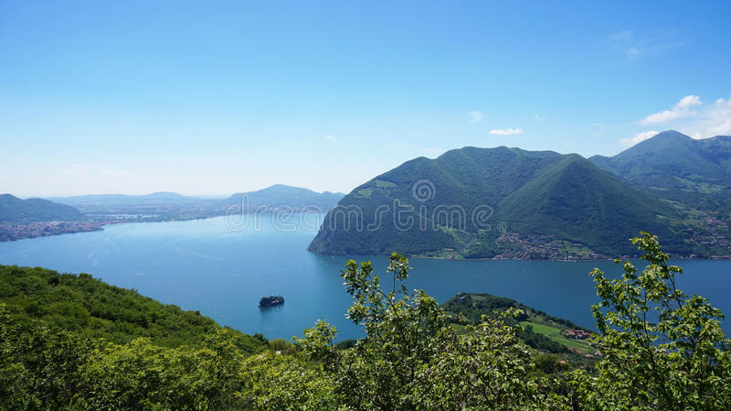 Lake panorama from `Monte Isola`. Italian landscape. Island on lake. View from the island Monte Isola on Lake Iseo, Italy.  royalty free stock photos