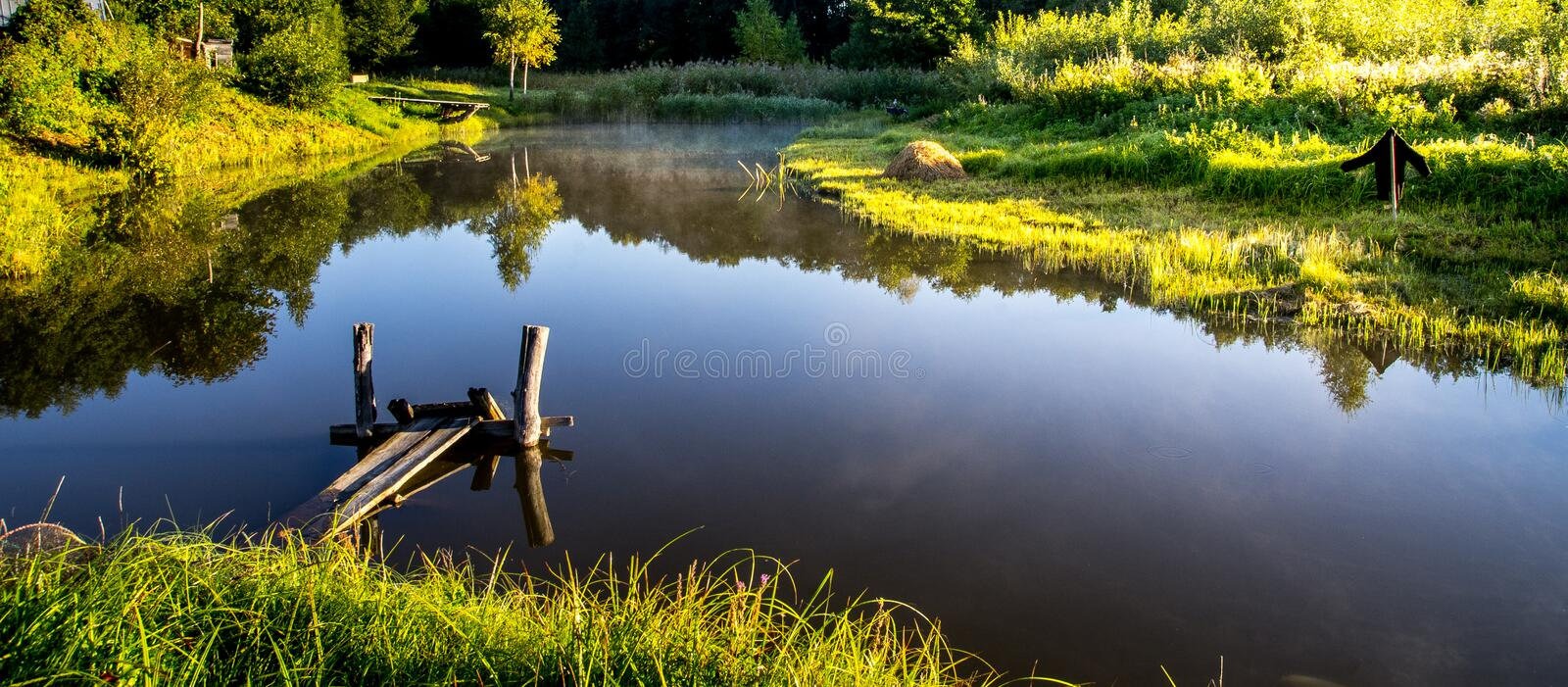 Lake panorama view. In soft summer light stock image