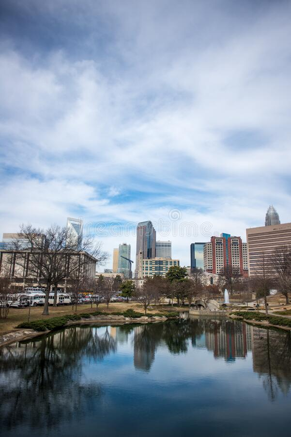 Lake and park in modern city royalty free stock image