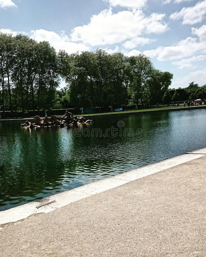Lake in the park of Versailles near Paris. stock photo