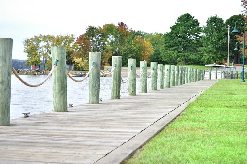 Lake pathway with fall foliage trees royalty free stock photography