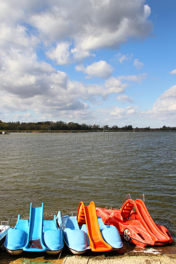 Lake with pedal boats stock images