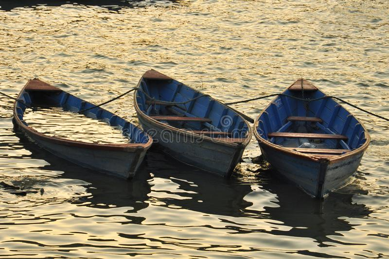Lake Phewa and the surrounding foothills, a landscape in golden. Boats and golden water Nepal, Pokhara: Lake Phewa and the surrounding foothills, a landscape in stock image