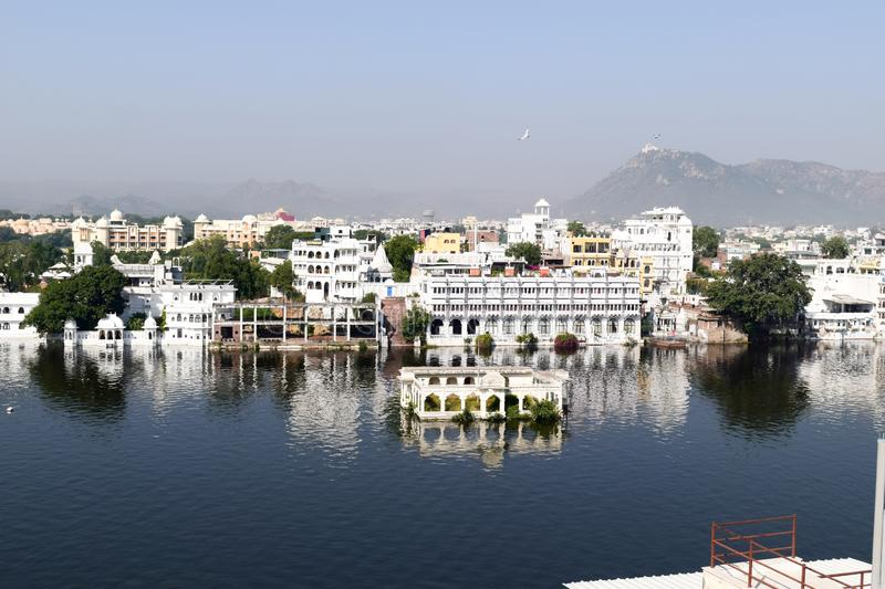 Lake Pichola, Udaipur city, Indian state of Rajasthan, May 2019 – Artificial fresh water lake, named after Picholi village. Two stock photos