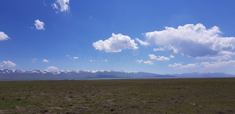 Song-Kol Lake literally `following lake`, Kyrgyzstan royalty free stock image