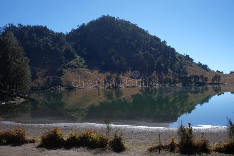 Lake Ranu Kumbolo, a source of clean water for the climbers of Mount Semeru. 08/18/2019: Lake Ranu Kumbolo, a source of clean water for the climbers of Mount royalty free stock photo