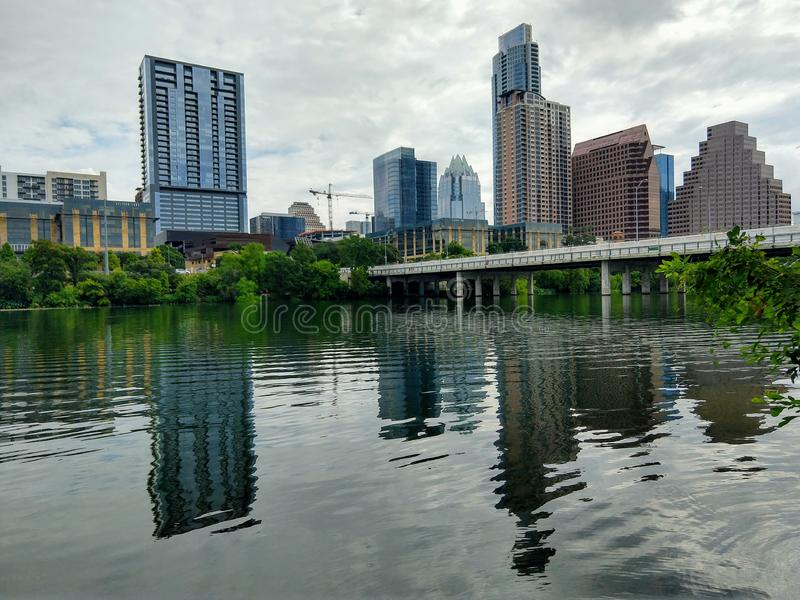 Lake reflection in downtown Austin TX. Lake, water, reflection, modern, building royalty free stock photos