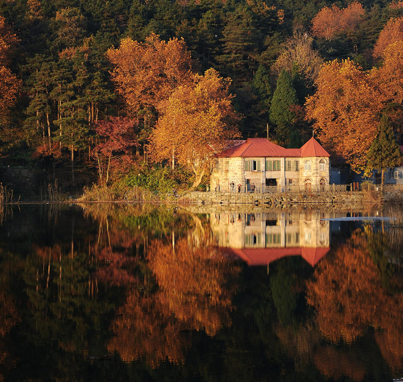 Lake reflections in fall stock photos