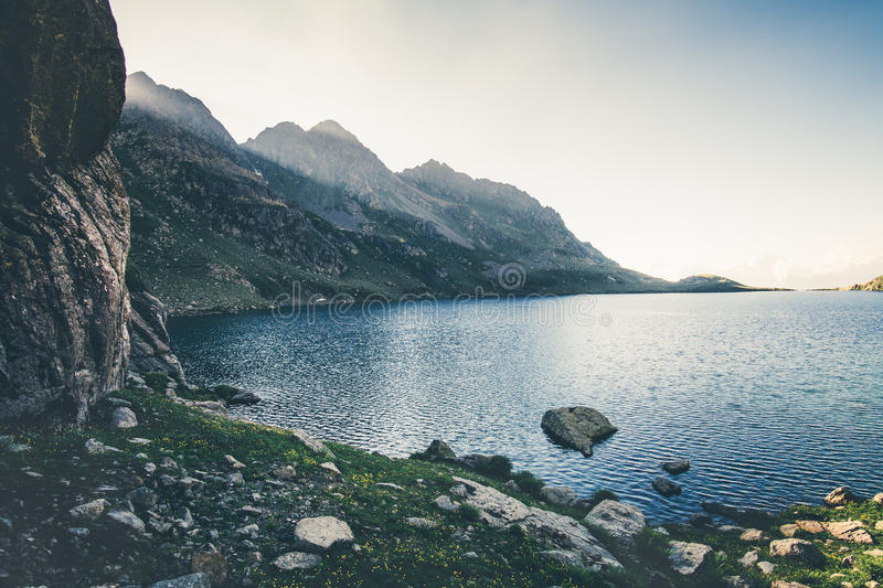 Lake and rocky Mountains Landscape. Summer Travel serene scenic view royalty free stock photography
