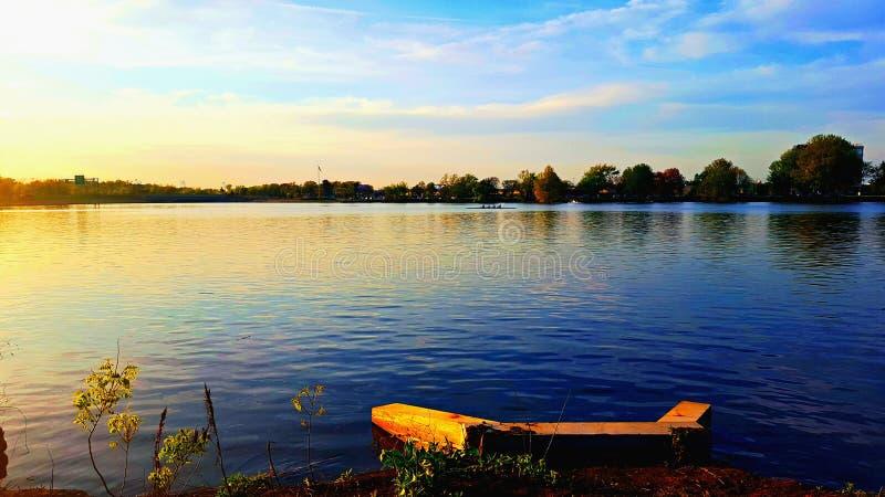 Lake and row boat royalty free stock photo