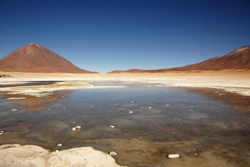 Lake in the Salar. A lake and mountains in the Salar Salt Desert, Uyuni, Bolivia royalty free stock photography