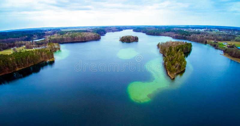 Lake scenery aerial Lithuania. Lake scenery aerial view. Forest and island visible from bird's view flight. Lithuania, Moletai region, lake Luokesai royalty free stock image