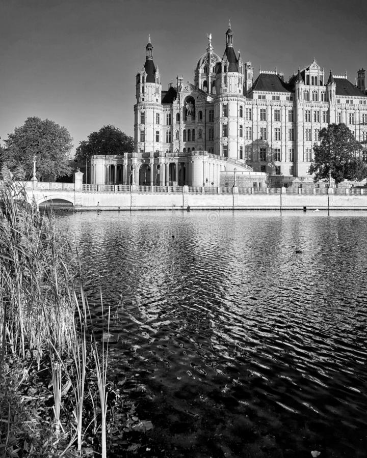 Lake with Schwerin castle in black and white in the background. Germany. Black-and-white, autumn, bridge, palace, europe, architecture, building, landmark stock images