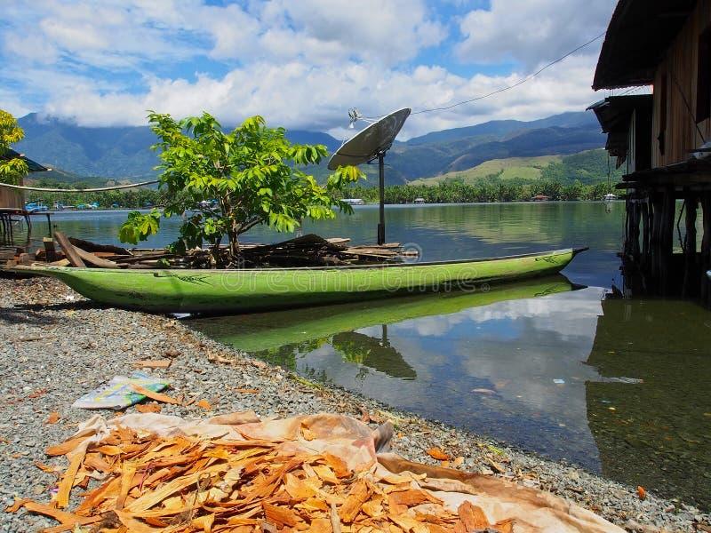 Lake Sentai. Jayapura, Indonesia - January 24, 2015: houses built on stilts stand in the waters of Lake Sentai stock photography