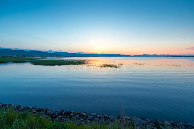 Lake Sevan in Armenia in the rays of the rising morning sun. Beautiful landscape stock images