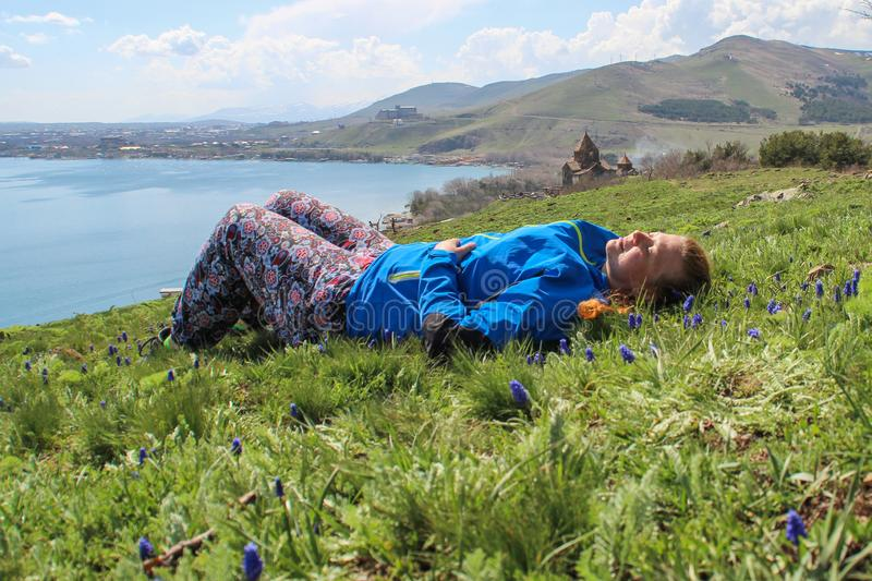 Lake Sevan is the largest body of water in Armenia and in the Caucasus region. Blue expanses of water, mountains, a meadow with fl stock photo