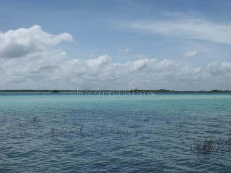 The colours of lake Bacalar Mexico. The lake of seven colours - Bacalar. All shades of blue interacting with each other stock photos