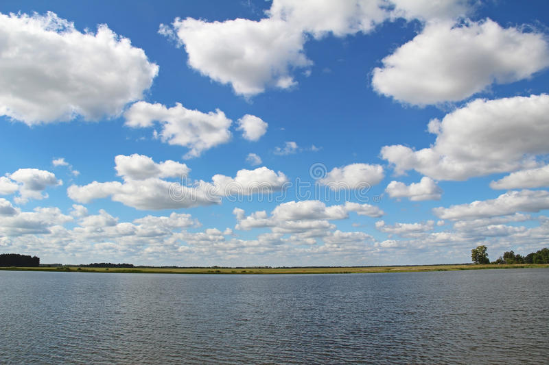 Lake shore and a beautiful cloudscape in summer. stock image