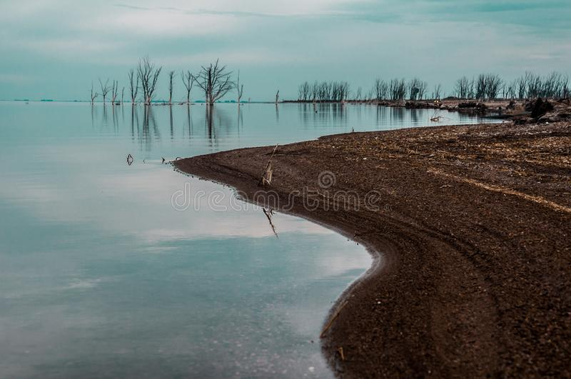 Lake shore on a cloudy day royalty free stock image