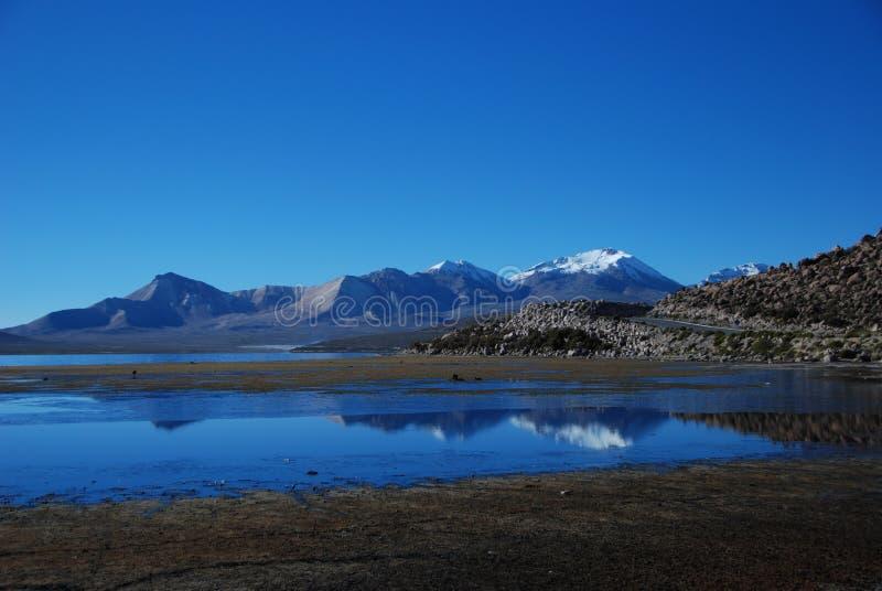 Lake shore and mountain ridge royalty free stock photo