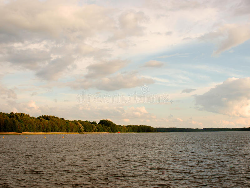 Lake with shore and sky stock photography