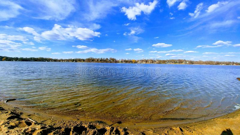 Lake shore in the spring stock images