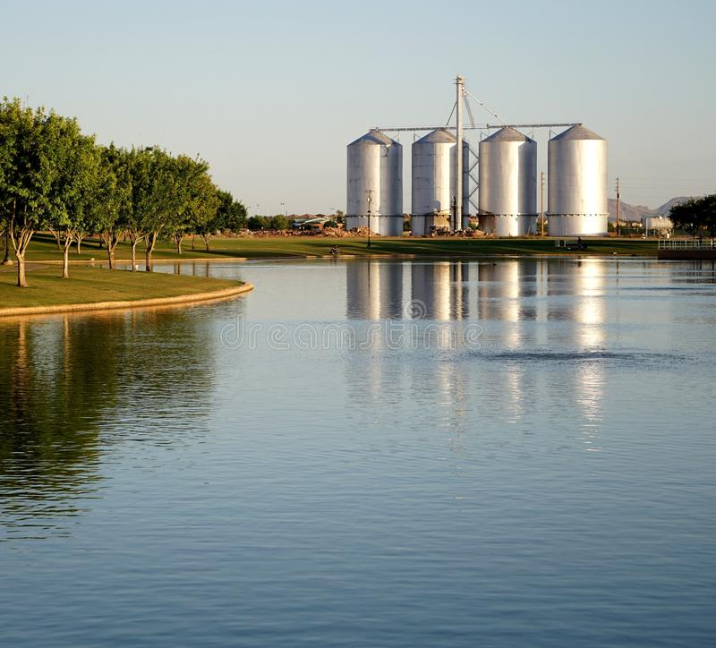 Lake with Silos in the Background stock images