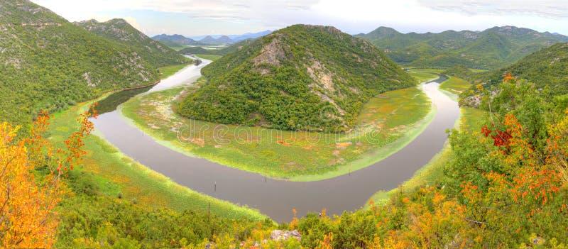 Lake Skadar in Montenegro. Panorama of the western end of lake Skadar near Rijeka Crnojevica in Montenegro. River like bends it around green mountain tops royalty free stock photos
