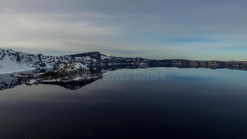 Lake and snow covered landscape stock photo