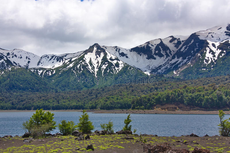 Lake and snow-covered mountains royalty free stock photos