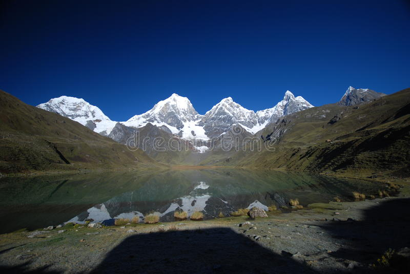 Lake and snow peaks of Peru stock photo