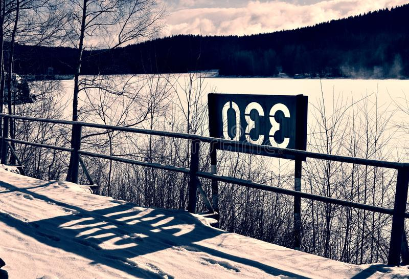 Lake, snow, sun stock image