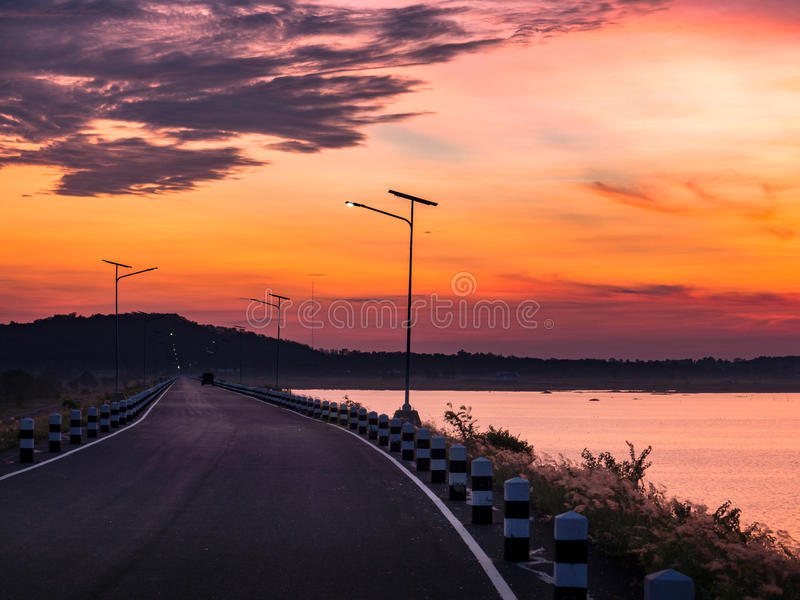 Lake sunrise and Beautiful view. Lake sunrise and Beautiful road view royalty free stock images