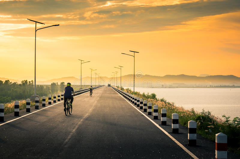 Lake sunrise and Beautiful view. Lake sunrise and Beautiful road view stock photo