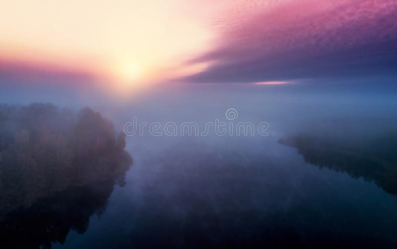 Lake at sunrise and mist stock photography