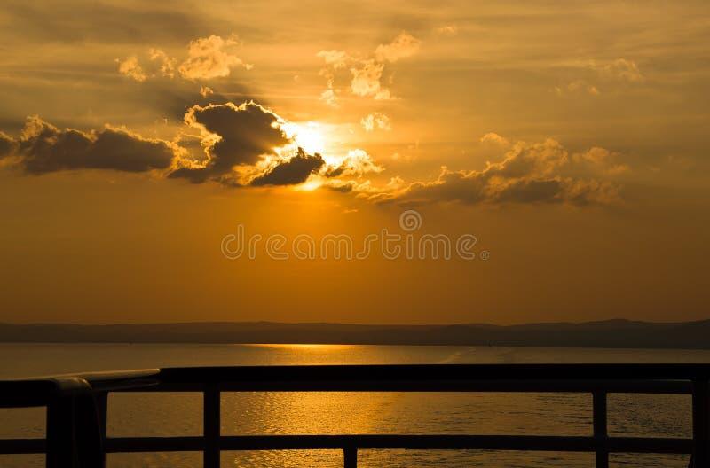 Lake sunset boat looking royalty free stock photo