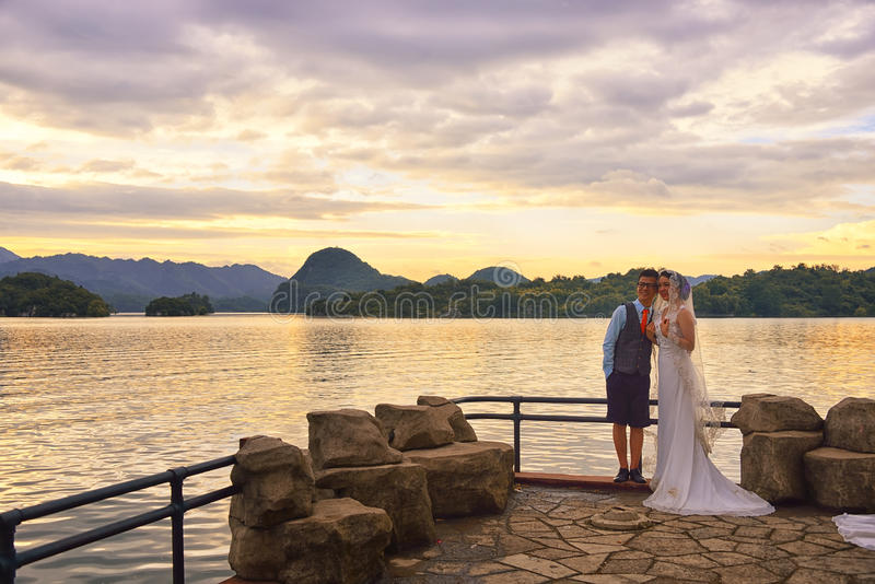 Download Lake Sunset And  Wedding Couple Editorial Image - Image of hills, water: 43588490