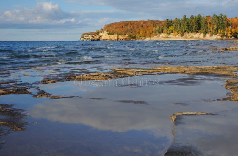 Lake Superior Shoreline. Landscape of the eroded sandstone shoreline of Lake Superior with reflections in rain pool, Pictured Rocks National Lakeshore, Michigan' stock image