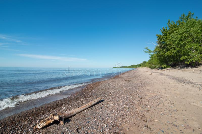 Lake Superior shoreline on a sunny summer`s day off coast in the Upper Peninsula of Michigan.  royalty free stock photo