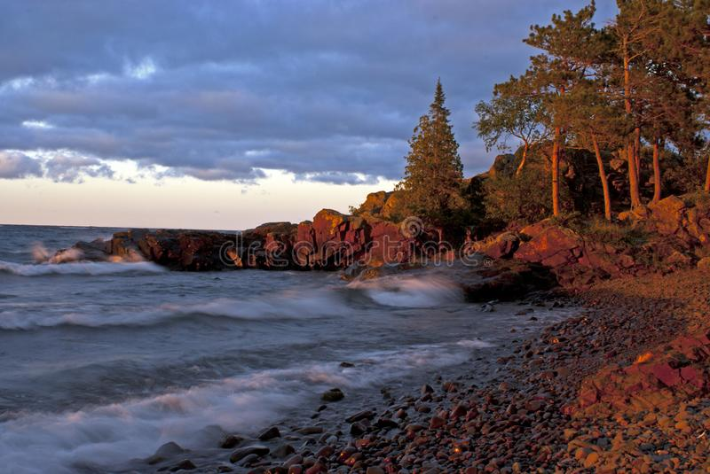 Lake Superior Shoreline at Sunset. Traveling to the Upper Peninsula in Michigan we always seemed to migrate to this spot when we stayed in Copper Harbor. When stock images