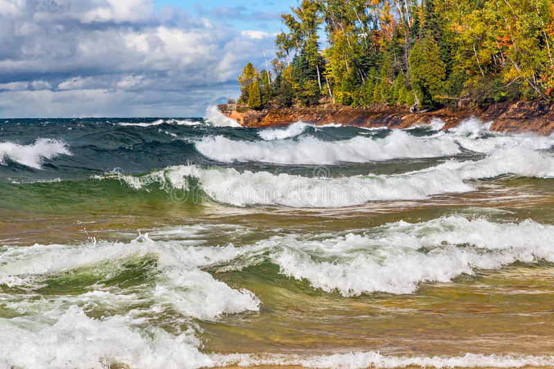 Lake Superior Surf. Waves crash on the rocky coast of Lake Superior at Michigan's Pictured Rocks National Lakeshore in autumn stock photos