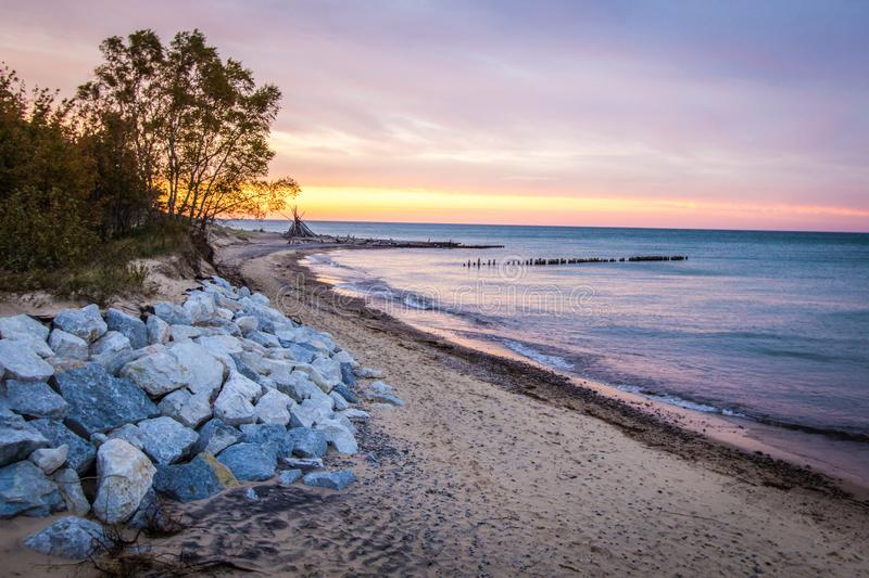 Lake Superior Whitefish Point On The Graveyard Coast. Michigan Beach Sunset. Sunset on the wild coast of Lake Superior with beach hut on the horizon in the Upper stock image