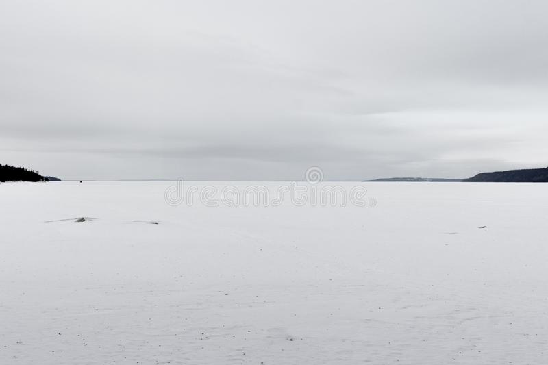 Lake surface covered with ice and snow stock photos