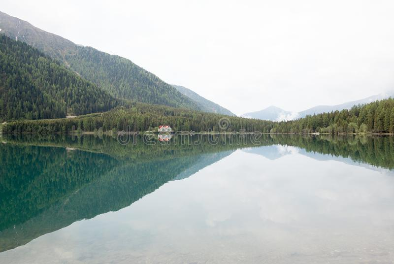 Lake surrounded by forest stock photo