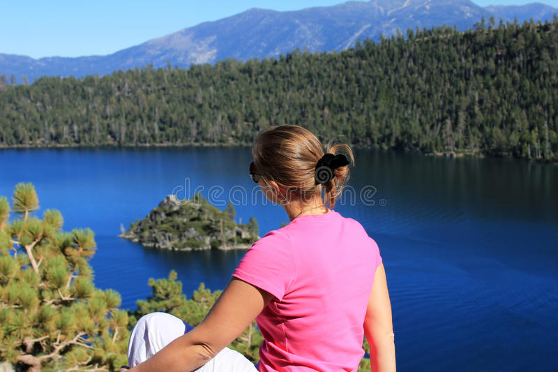 Lake Tahoe. The girl sits on a coast of Lake Tahoe stock photography