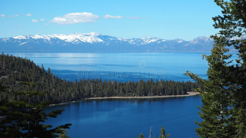 Lake Tahoe. Is a large freshwater lake in the Sierra Nevada of the United States. Lying at 6,225 ft 1,897 m, it straddles the border between California and royalty free stock images