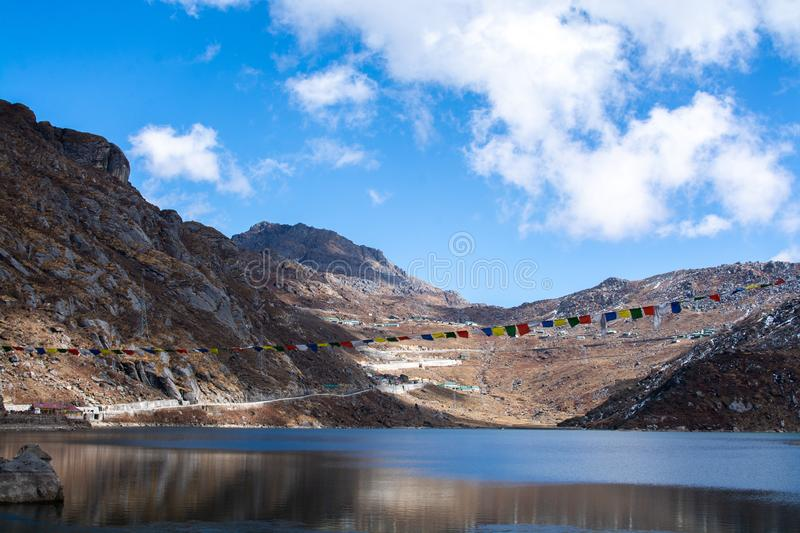 Lake in valley with mountains and blue sky and clouds background, Himalaya mountains in India royalty free stock photos