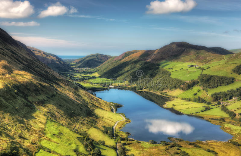Lake in a valley stock images