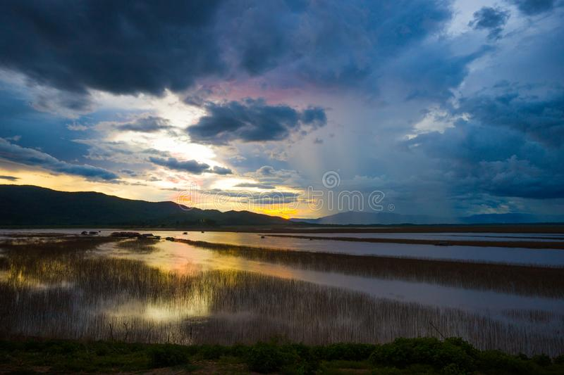 Download Lake View Floating House Boat Of Fishing Village At Sunset With Cloud, Rain And Storm. Stock Photo - Image of nature, floating: 117713760