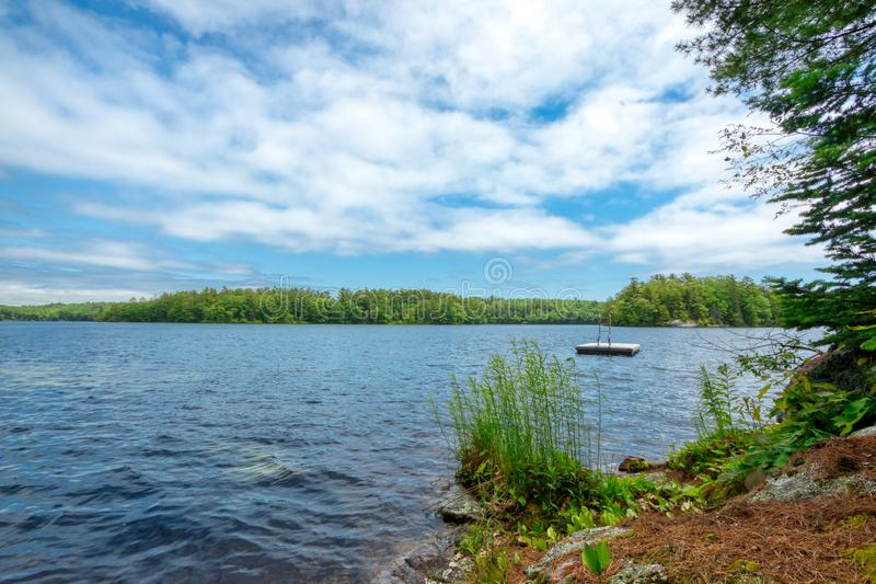 Lake view in Maine with clouds royalty free stock photography